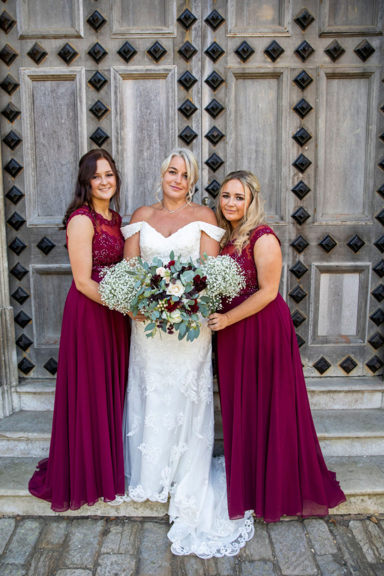 Bride and bridesmaids with bouquets