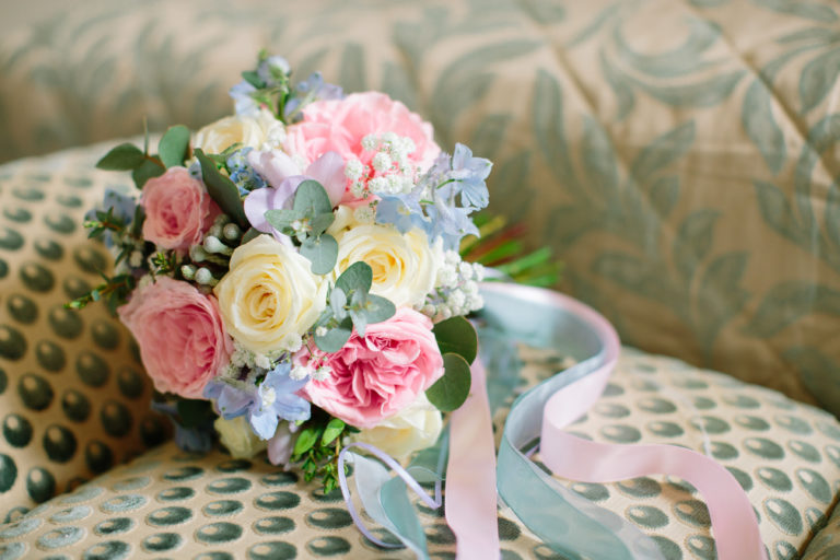 Pastel brides bouquet with trailing ribbons