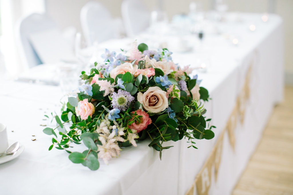 Pastel wedding reception flowers