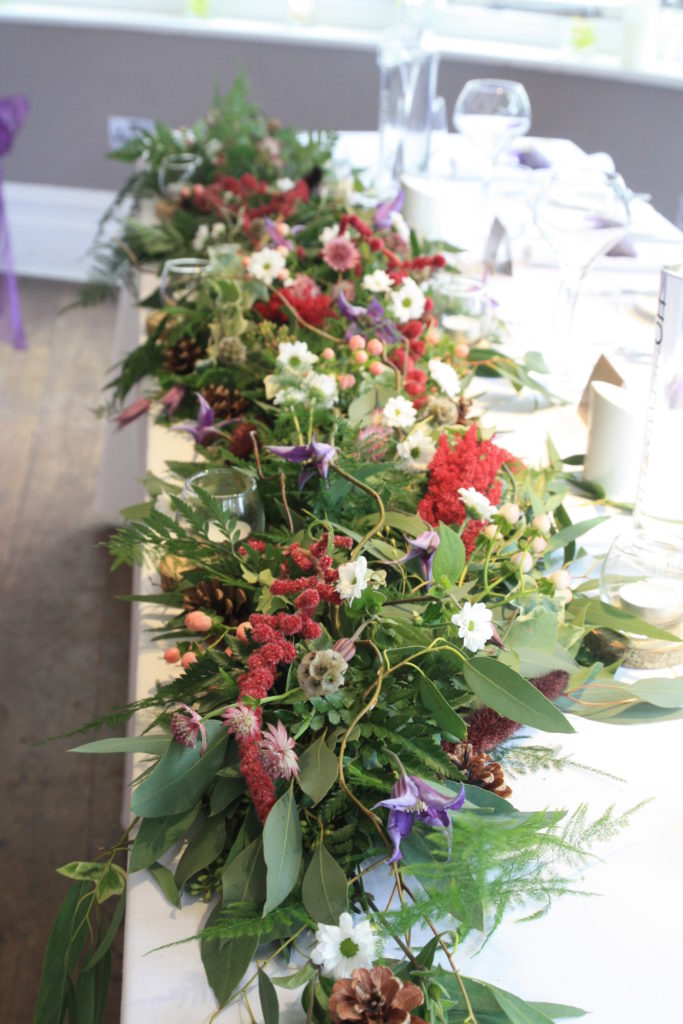 Garland of flowers on the top table