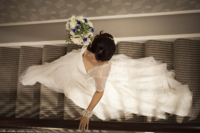 Bride walking down the stairs with bridal bouquet