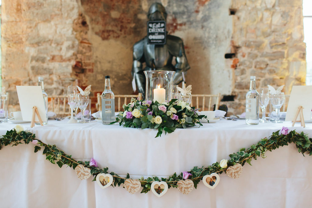 Top table wedding flowers at Lulworth Castle