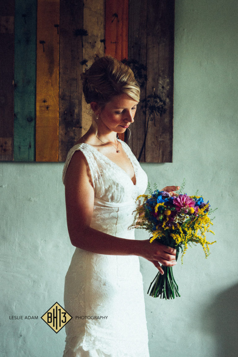 Bride holding a bouquet of summer flowers