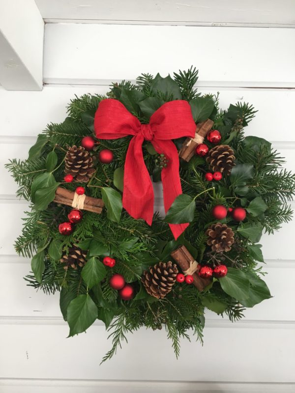 Christmas wreath with red accessories