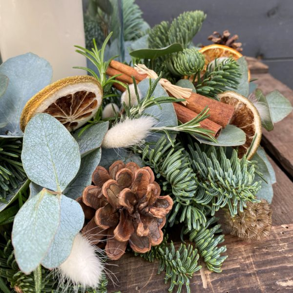 Handmade Christmas table decoration with a candle
